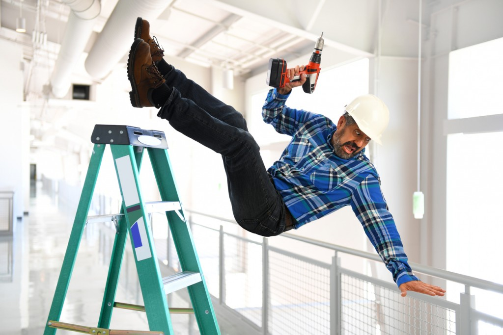 Man falling from ladder at work